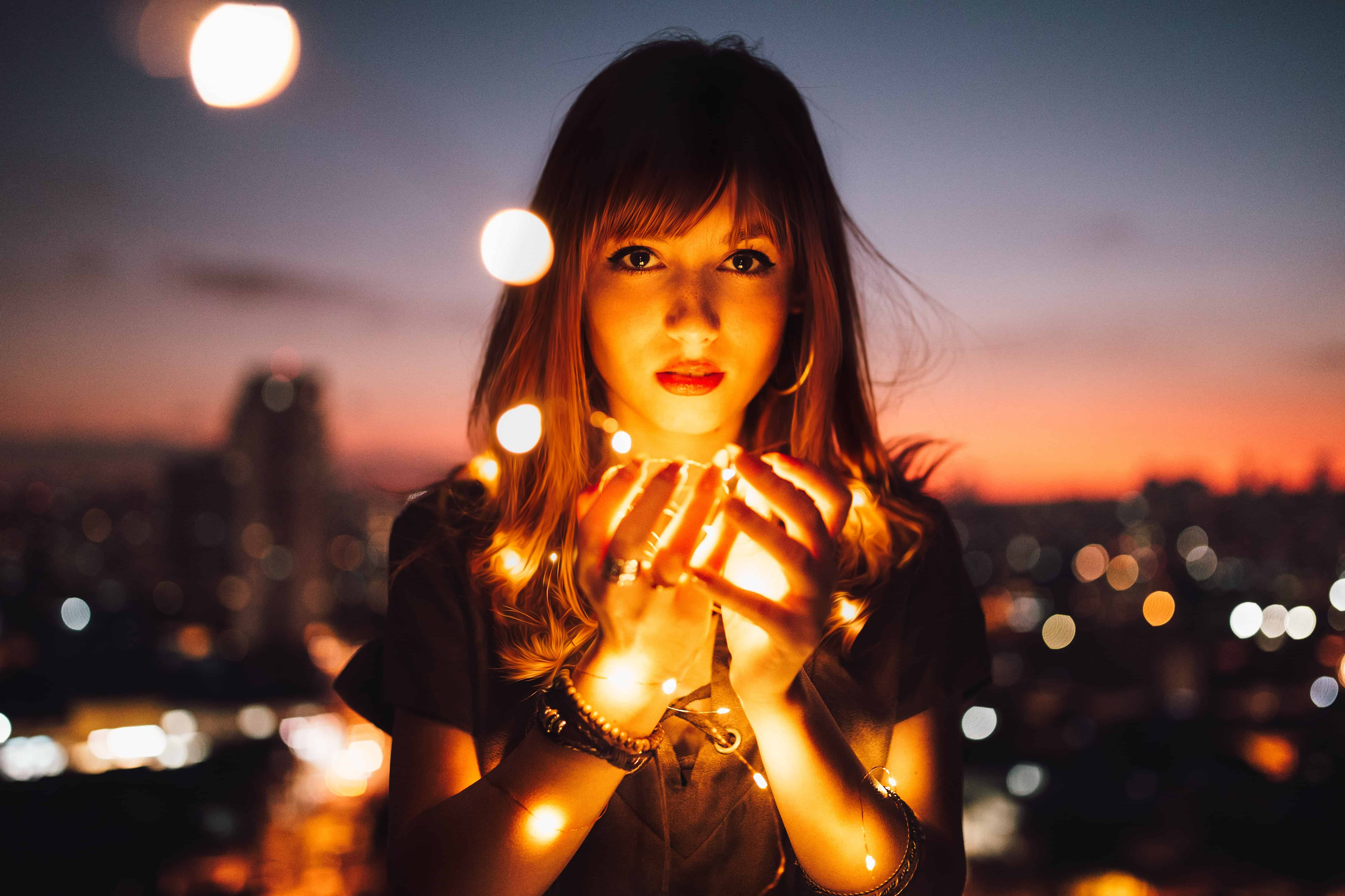 still of woman surrounded by tea lights