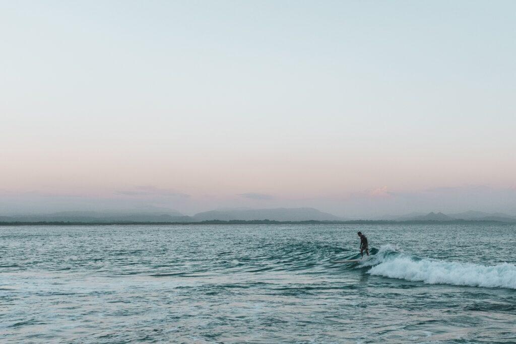 Surfing adventure activity in Byron Bay, Australia