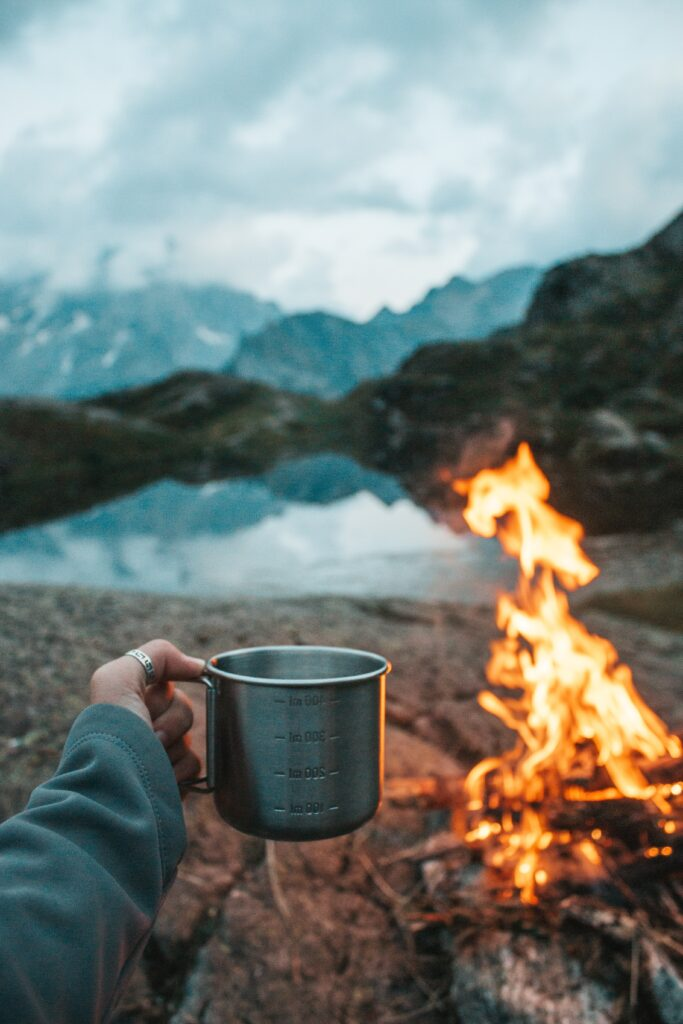 Holding coffee mug while camping