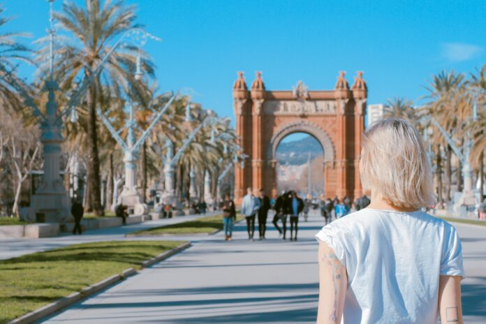 Woman at the Arco de Triunfo de Barcelona Spain