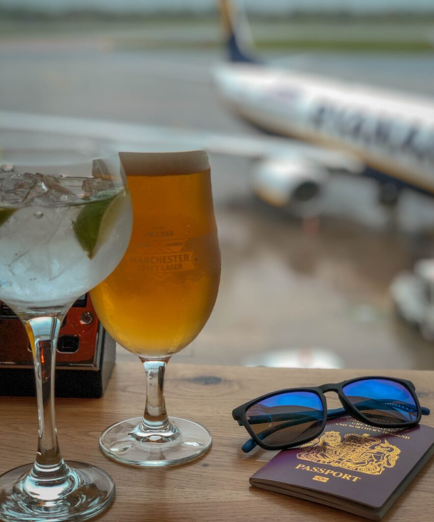a beer and cocktail at the airport lounge