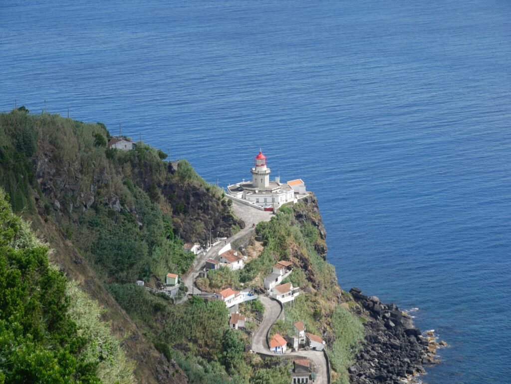 Lighthouse on a cliff, the Azores, Portugal