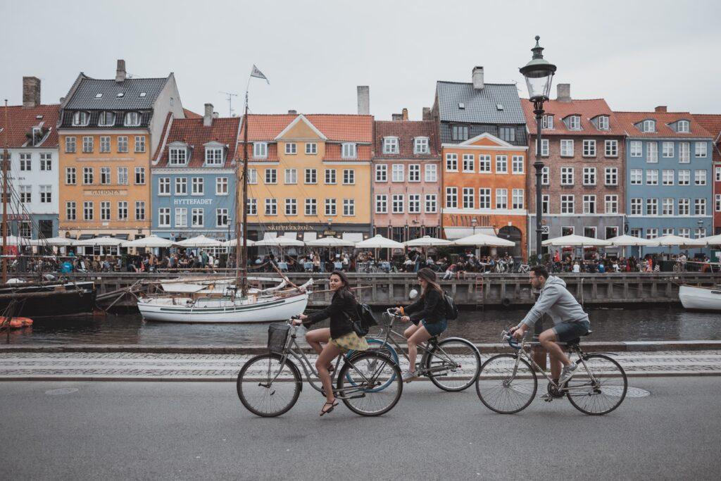 three people biking in Copenhagen, sustainable transportation