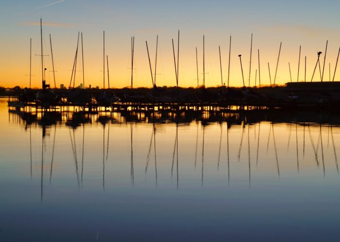 Sailboat silhouettes create calm feelings
