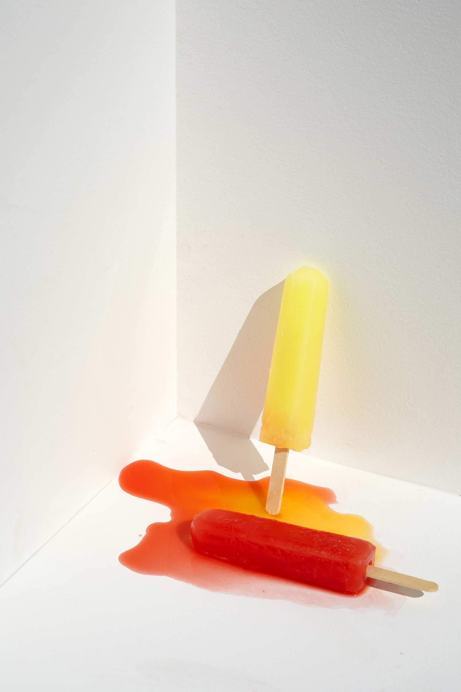 Popsicle melting still life on a hot summer day
