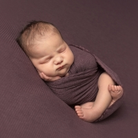 Newborn photography - baby girl in dusty purple wrap