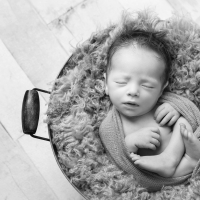 Newborn photography - baby boy in bucket; black & white