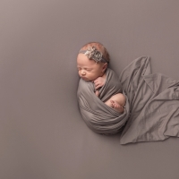 Newborn photography - girl in grey wrap with headband