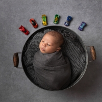 Rainbow baby boy with cars