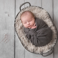 Newborn photography - boy in basket photo