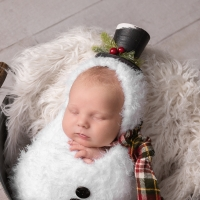 Newborn Photo of brand new baby in snowman suit