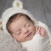 newborn baby in bear hat photo