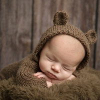 Photo of newborn boy in Bear suit