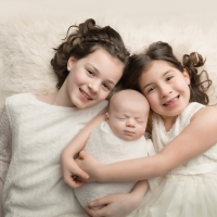 Photo of newborn with siblings