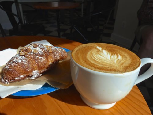 An almond croissant and cappuccino from Bakers & Co.