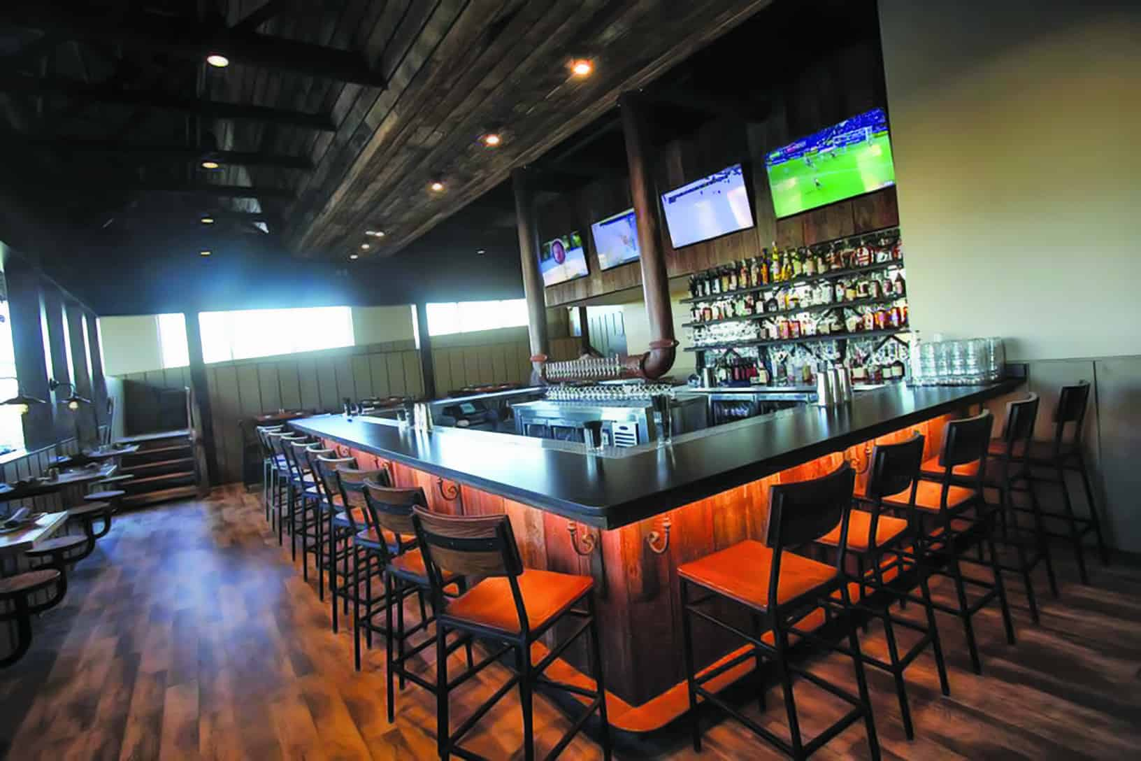 The bar at Food Plenty in Clarksville serves Manor Hill beer on tap.