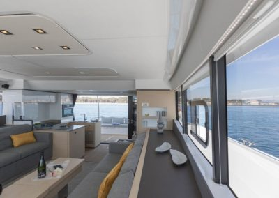 Salon seating with windows surrounding with views of ocean