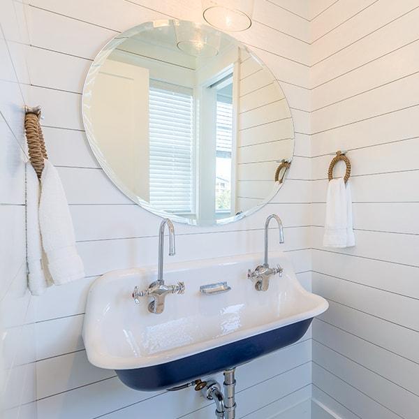 Sugar Beach Interiors, Miramar Beach, Florida. White coastal bathroom with vintage sink