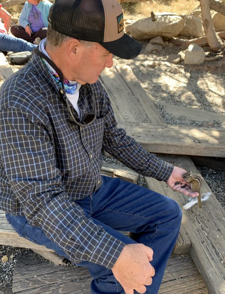Feeding Chipmunks in Ghost Town of St. Elmo Colorado