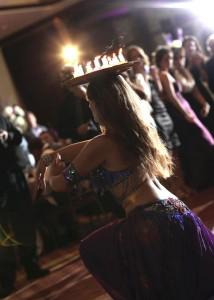 Hire Belly dancer New York Mariyah with candles at a wedding at Hilton Staten Island NY- Photo by Matt Ramos