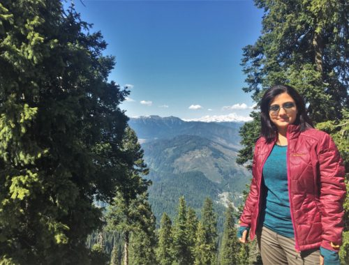 Taking a break and appreciating the landscape at one of the many hairpin bends to Sadhna Top.