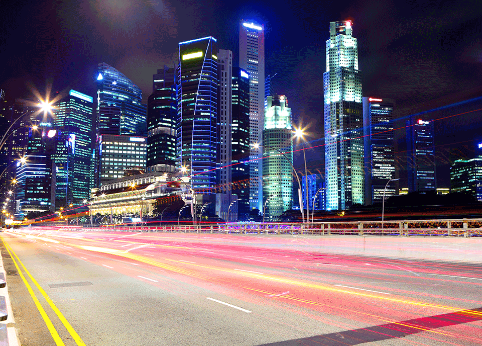 High speed traffic going past buildings.