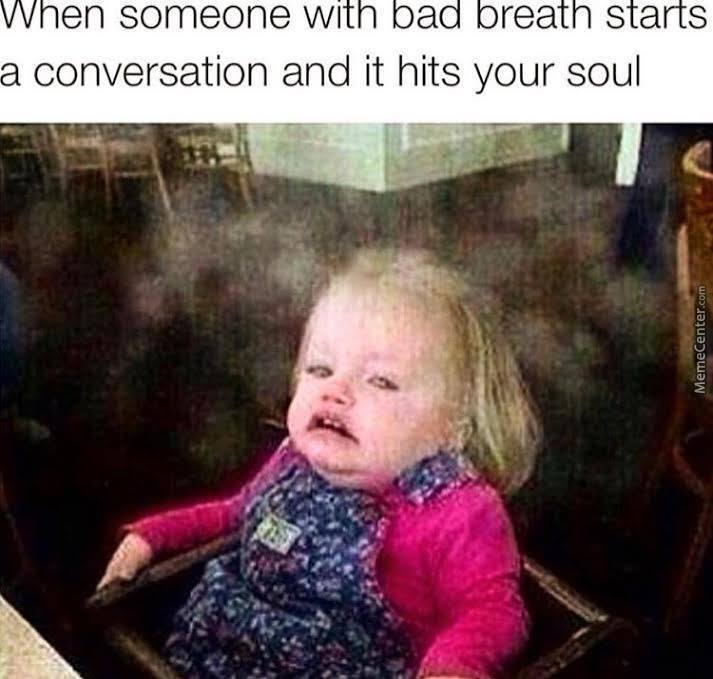 Meme of a white baby girl with her face made up as she smells bad breath.