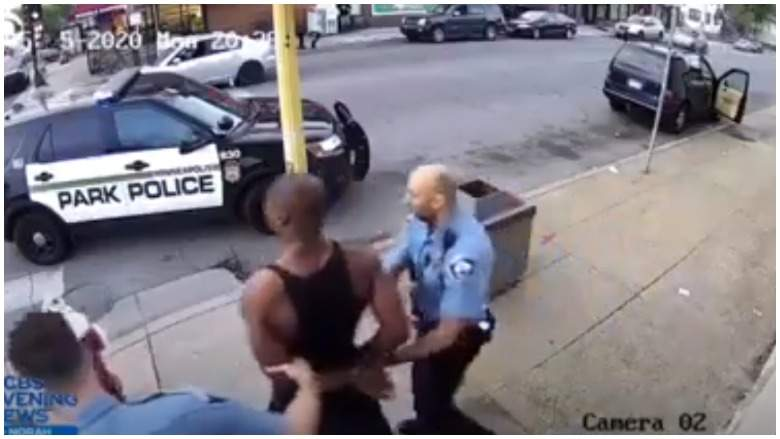 Surveillance footage of George Floyd being arrested minutes before his death.