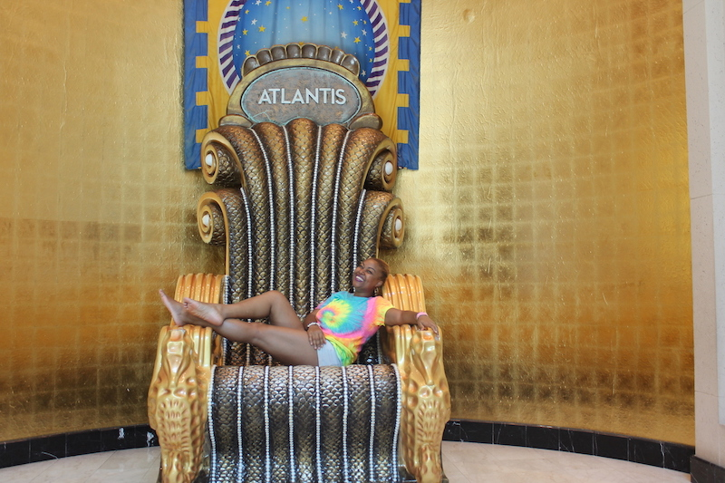 Rogan Smith lounges on the throne in Atlantis.