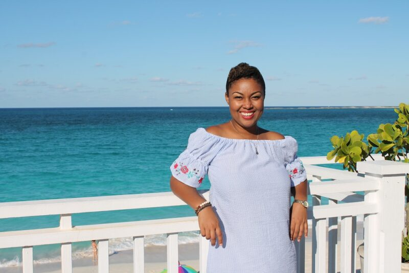 This Bahamian Gyal Creative Director, Rogan Smith poses in front of Cabbage Beach on Paradise Island. The beaches in The Bahamas are set to reopen on June 29.