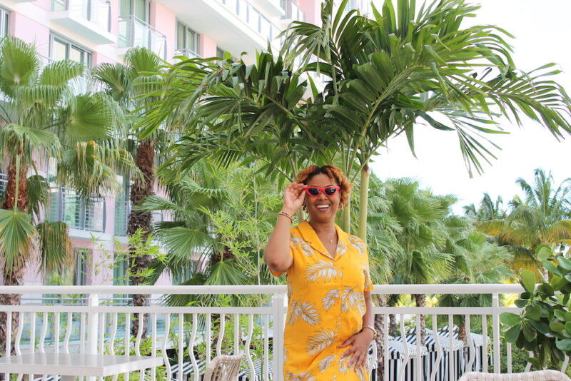 Blogger Rogan Smith poses in front of the Baha Mar resort in Nassau, Bahamas. Baha Mar will not reopen until October even though the country will open on July 1.