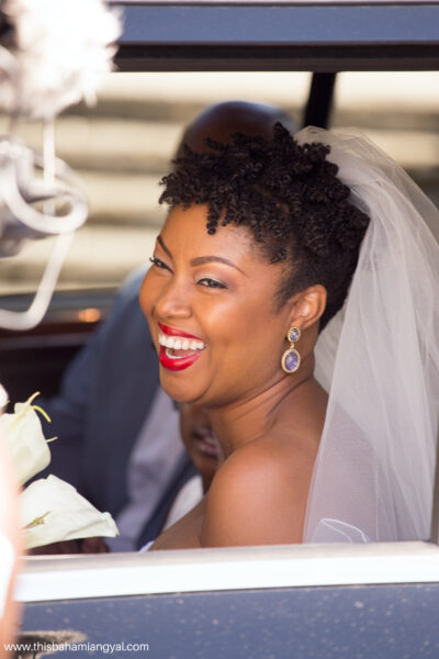 This Bahamian Gyal blogger, Rogan Smith gets ready to exit the vehicle as she celebrates her eighth wedding anniversary at their vow renewal ceremony in The Bahamas.