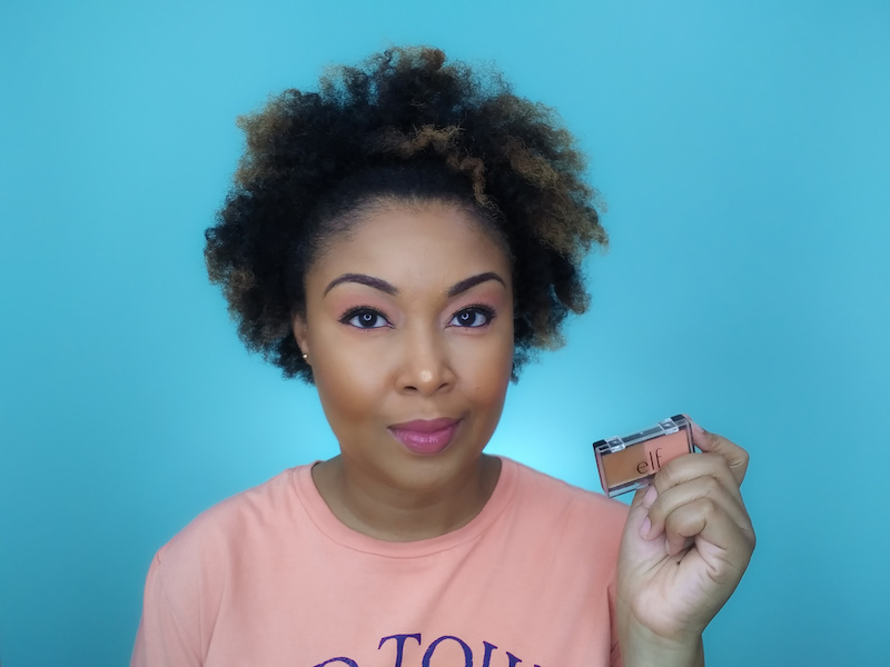 DC-based blogger, Rogan Smith holds the ELF Peach Squad palette in her hand.
