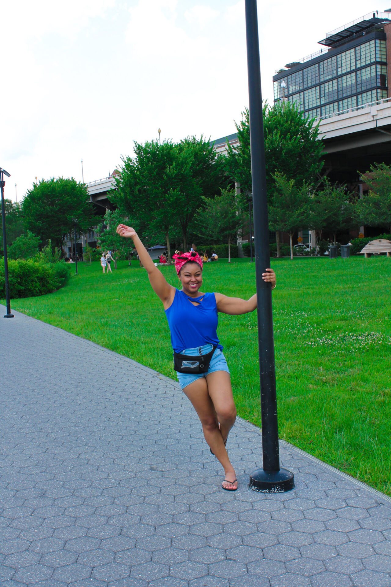 DC blogger, Rogan Smith of This Bahamian Gyal, swings on a pole in Georgetown, DC.