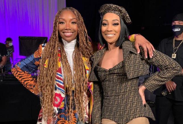R&B singer Brandy poses with singer, Monica for their verzuz battle