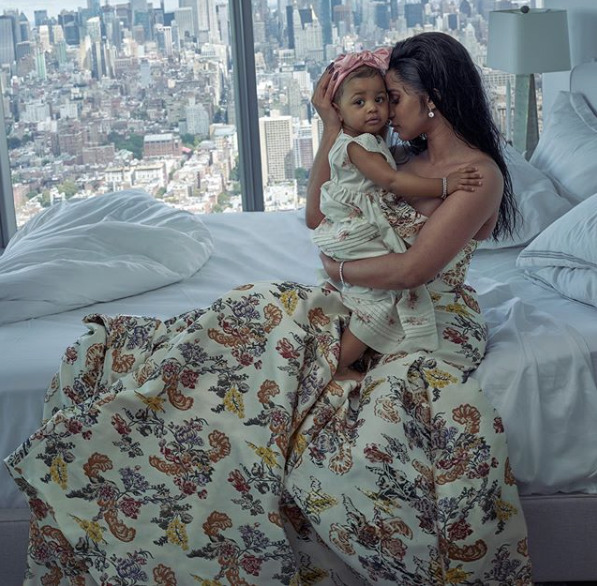 Rapper Cardi B sits on a bed posing with her daughter, Kulture for a magazine shoot. Photo/Cardi B's Instagram