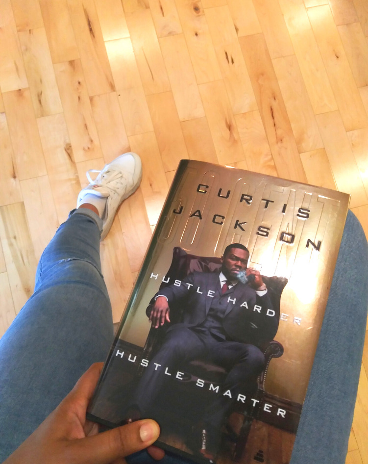 """This Bahamian Gyal blogger, Rogan Smith holds a copy of Curtis """"50 Cent"""" Jackson's book, Hustle Harder, Hustle Smarter in her hand."""