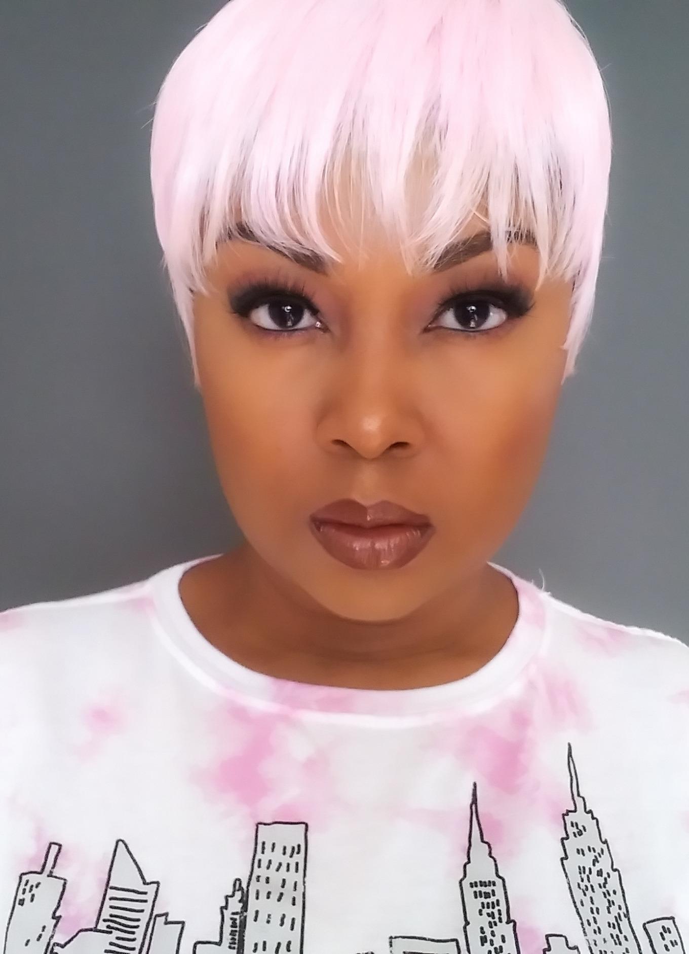 light skinned black woman wearing pink wig
