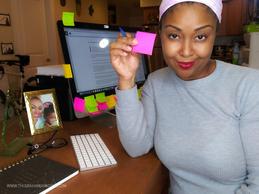 This Bahamian Gyal Creative Director and blogger, Rogan Smith holds up a sticky note. She goes through a ton of these in any given week and is always making notes of things to do for her blog.