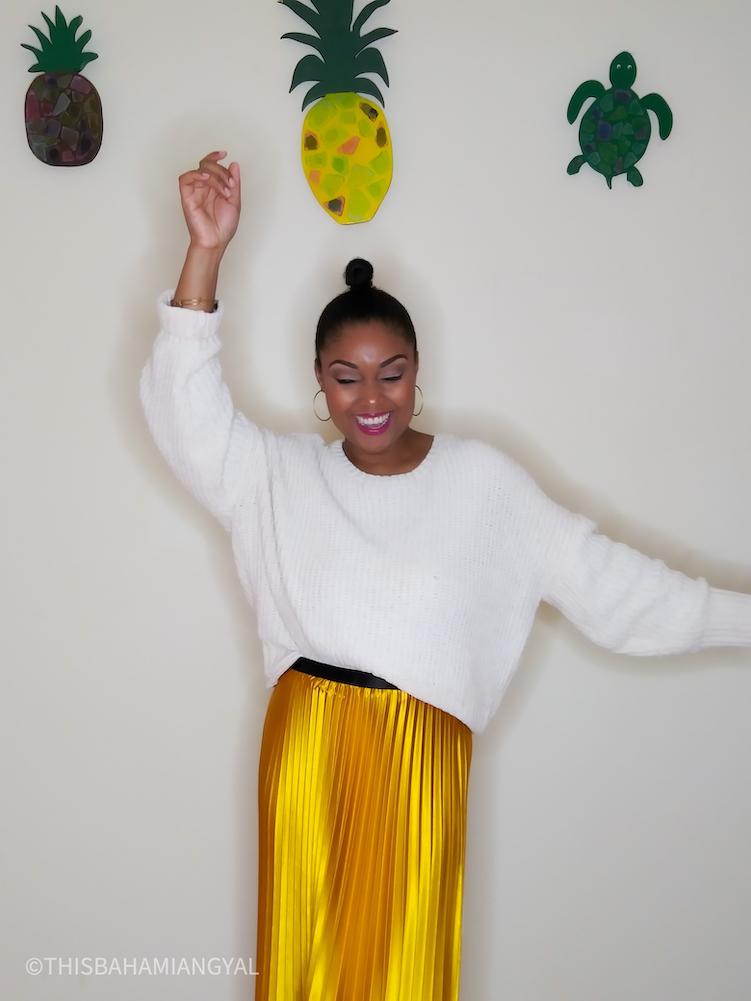 All smiles. Washington, DC blogger and YouTuber, Rogan Smith wears a yellow satin midi skirt.