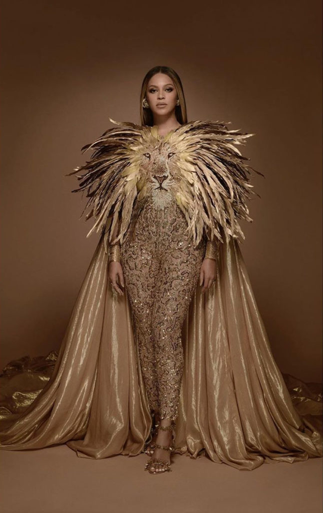 Singer, Beyonce wears a gold Lion head jumpsuit for the Wearable Art Gala.