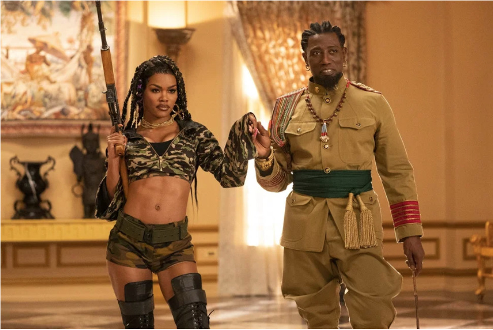 Photo of Teyana Taylor and Wesley Snipes in a scene from Coming 2 America