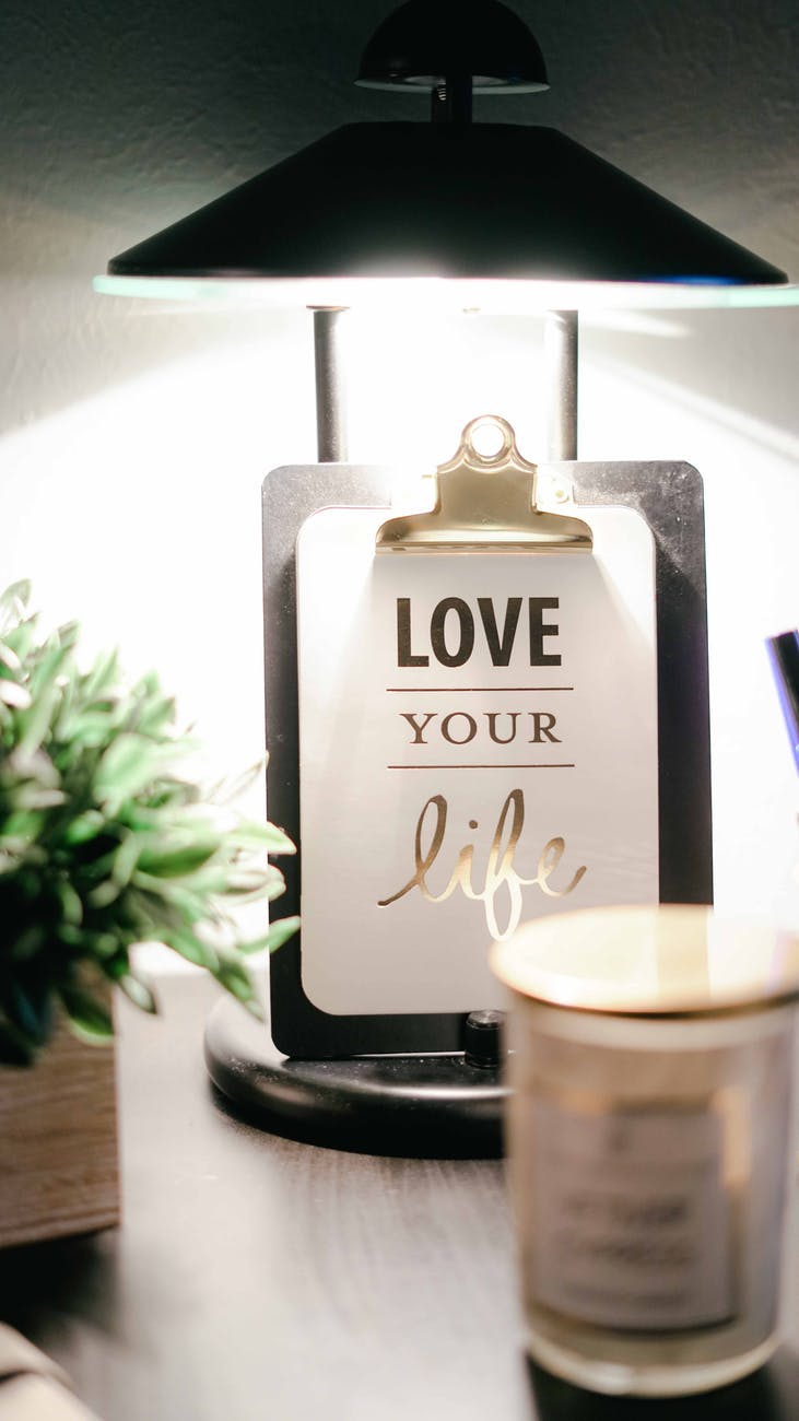 """Photo on nightstand that says, """"love your life."""""""