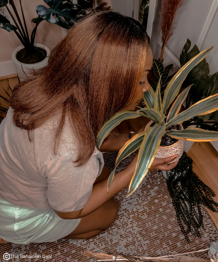 Washington DC blogger Rogan Smith sits on the floor and smells her plants