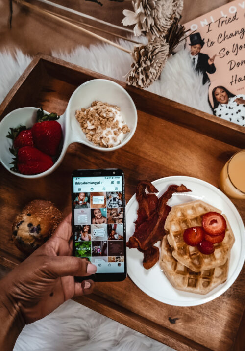 Flat lay of breakfast, cell phone with instagram