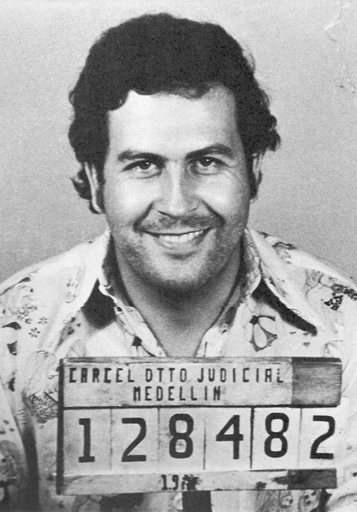 Mugshot of notorious drug kingpin, Pablo Escobar. Escbobar smiles in his mugshot.