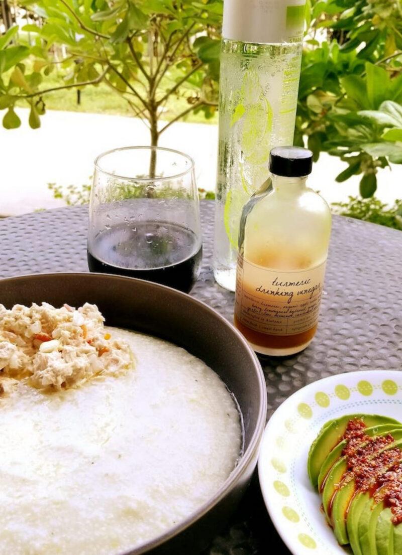 Traditional Bahamian breakfast tuna fish and grits and avocado