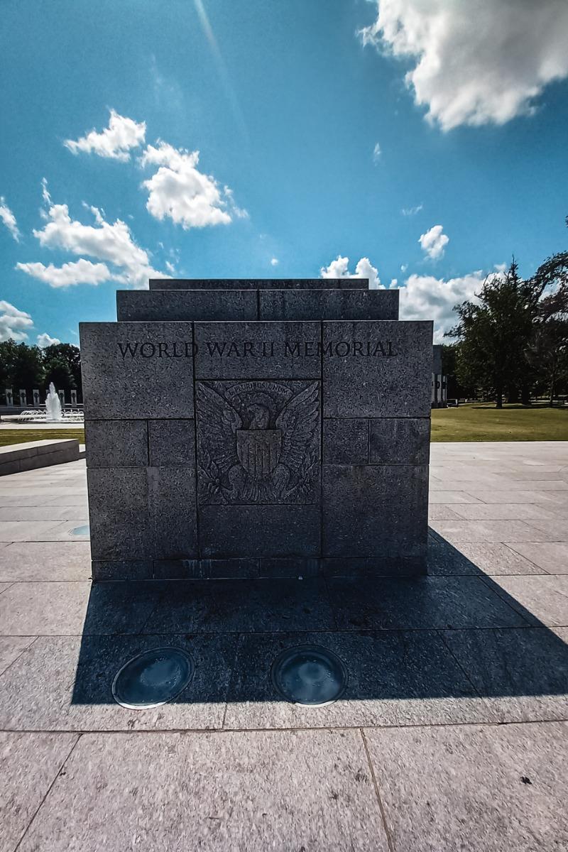 Stone image of the World War II Memorial in Washington, DC