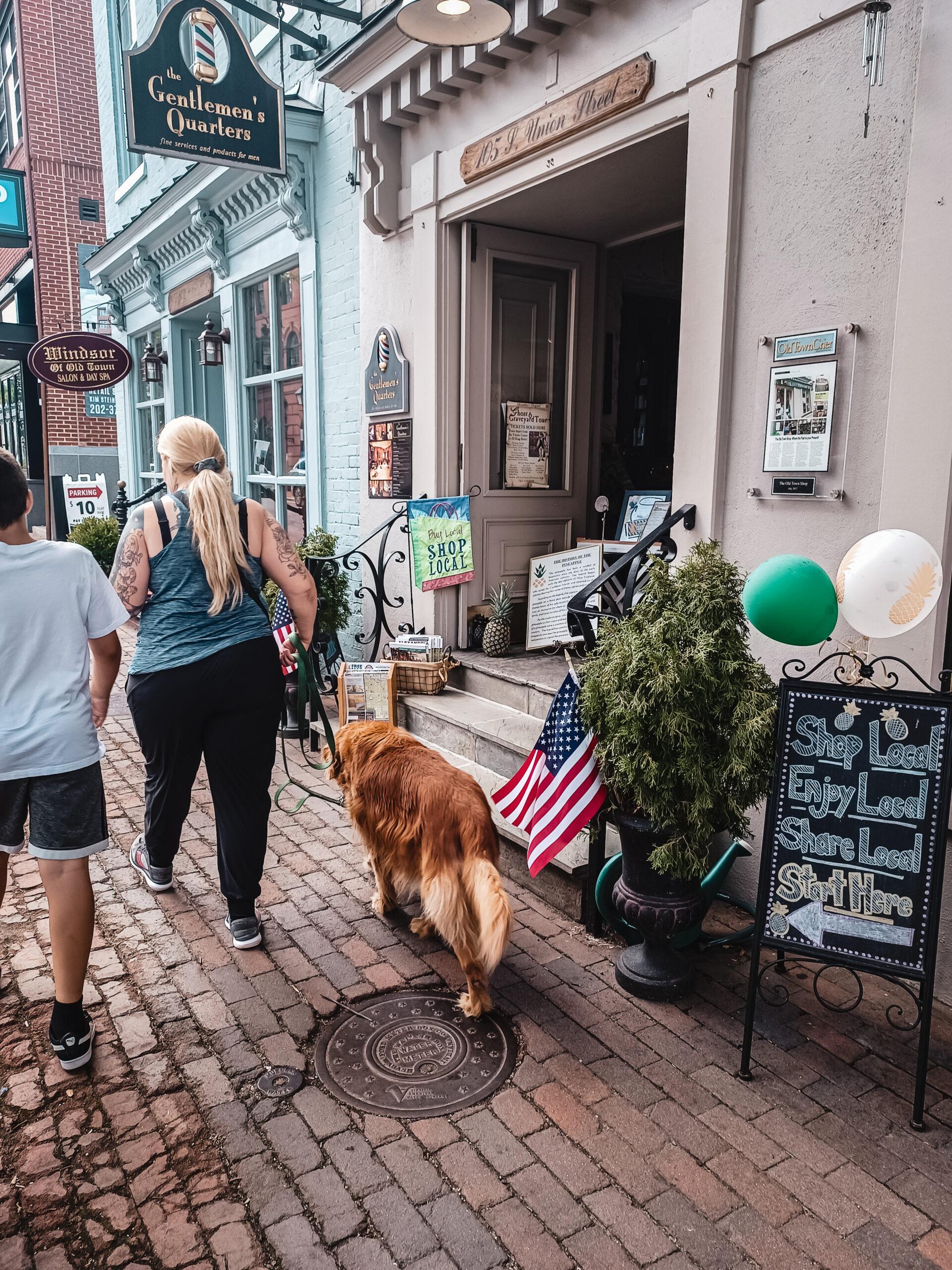 A woman walks her golden retriever dog in Alexandria Virginia This Bahamian Gyal