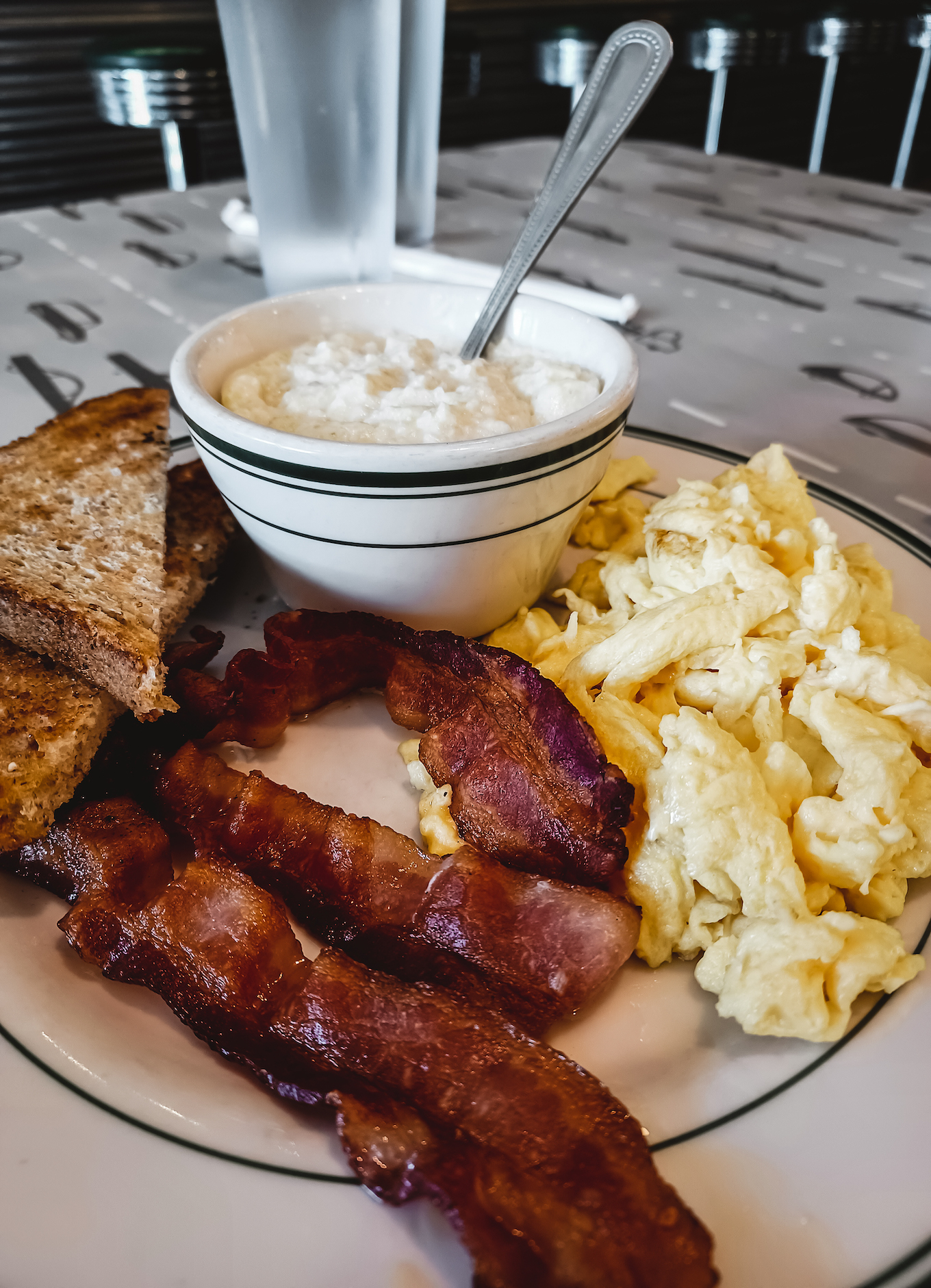 All American breakfast with bacon, eggs and grits